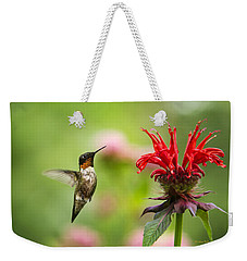 Male Ruby-throated Hummingbird Hovering Near Flowers Weekender Tote Bag by Christina Rollo