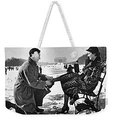 Man Lends A Helping Hand To Put On Skates Weekender Tote Bag by Underwood Archives