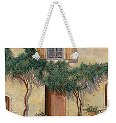 Mezza Bicicletta Sul Muro Weekender Tote Bag by Guido Borelli