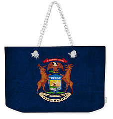Michigan State Flag Art On Worn Canvas Weekender Tote Bag by Design Turnpike