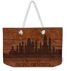 New York City Skyline Silhouette Distressed On Worn Peeling Wood Weekender Tote Bag by Design Turnpike