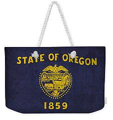 Oregon State Flag Art On Worn Canvas Weekender Tote Bag by Design Turnpike