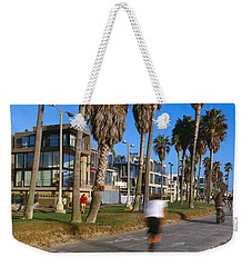 People Riding Bicycles Near A Beach Weekender Tote Bag by Panoramic Images