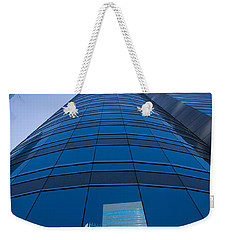 Reflection Of Buildings On A Stock Weekender Tote Bag by Panoramic Images