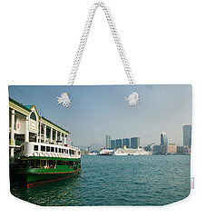 Star Ferry On A Pier With Buildings Weekender Tote Bag by Panoramic Images