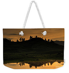Weekender Tote Bag featuring the photograph Sunrise Behind A Yellowstone Ridge by Bill Gabbert