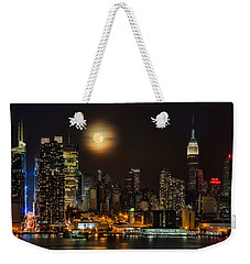 Super Moon Over Nyc Weekender Tote Bag by Susan Candelario