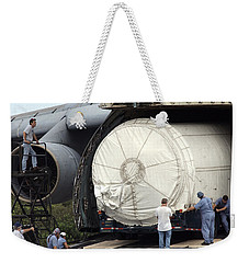 Weekender Tote Bag featuring the photograph Unloading A Titan Ivb Rocket by Science Source