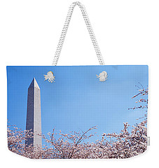 Washington Monument Behind Cherry Weekender Tote Bag by Panoramic Images