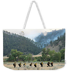 Weekender Tote Bag featuring the photograph Wyoming Hot Shots Walk To Their Assignment by Bill Gabbert