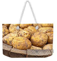 Freshly Harvested Potatoes In A Wooden Bucket Weekender Tote Bag by Tom Gowanlock