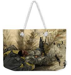 U.s. Army Specialist Takes A Nap Weekender Tote Bag by Stocktrek Images