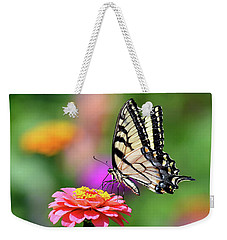 Weekender Tote Bag featuring the photograph Swallowtail On A Zinnia by Rodney Campbell