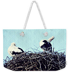 A Happy Stork Couple Weekender Tote Bag by Sarah Loft