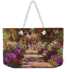 A Pathway In Monets Garden Giverny Weekender Tote Bag by Claude Monet