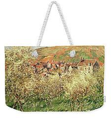 Apple Trees In Blossom Weekender Tote Bag by Claude Monet