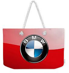 B M W Badge On Red  Weekender Tote Bag by Serge Averbukh