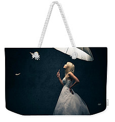 Girl With Umbrella And Falling Feathers Weekender Tote Bag by Johan Swanepoel