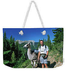 Man Posing With A Llama On A High Mountain Trail Weekender Tote Bag by Jerry Voss