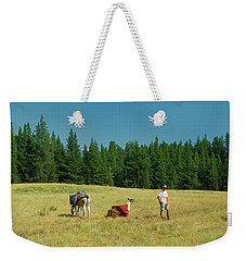 Man Posing With Llamas In A Beautiful Grassy Meadow Weekender Tote Bag by Jerry Voss
