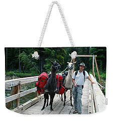 Man Posing With Two Llamas On Wilderness Drawbridge Weekender Tote Bag by Jerry Voss
