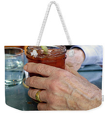 Mans Hand Holding Bloody Mary  Weekender Tote Bag by Beth Wolff