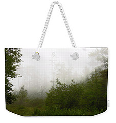 Weekender Tote Bag featuring the photograph Mountain Forest Thicket In Fog by A Gurmankin
