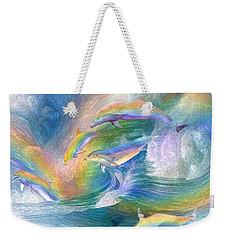 Rainbow Dolphins Weekender Tote Bag by Carol Cavalaris