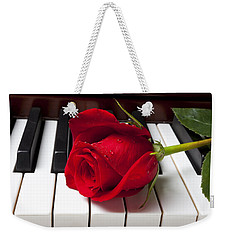 Red Rose On Piano Keys Weekender Tote Bag by Garry Gay