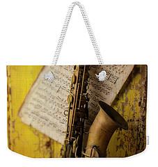 Saxophone Hanging On Old Wall Weekender Tote Bag by Garry Gay