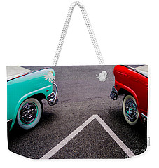 Weekender Tote Bag featuring the photograph Two 1958 Ford Crown Victorias by M G Whittingham