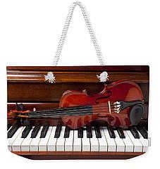 Violin On Piano Weekender Tote Bag by Garry Gay