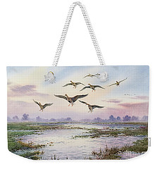White-fronted Geese Alighting Weekender Tote Bag by Carl Donner