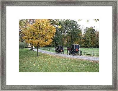 An Autumn Amish Ride Framed Print by R A W M