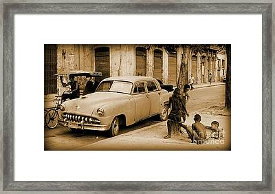 Children Play Outside The Old Way Framed Print by John Malone