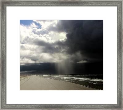 Hurricane Glimpse Framed Print by Karen Wiles