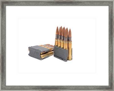 M1 Garand Clips And Ammunition On White Background.  Framed Print by John Bell