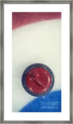 Red Curling Stone Framed Print by Priska Wettstein