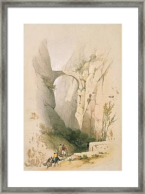 Triumphal Arch Crossing The Ravine Leading To Petra Framed Print by David Roberts