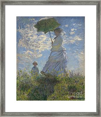 Woman With A Parasol Madame Monet And Her Son Framed Print by Claude Monet
