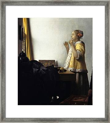 Young Woman With A Pearl Necklace Framed Print by Johannes Vermeer