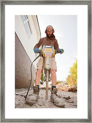 A Builder Using A Jack Hammer Framed Print by Ashley Cooper
