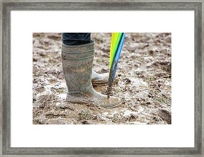 A Field Churned Up Into Mud Framed Print by Ashley Cooper