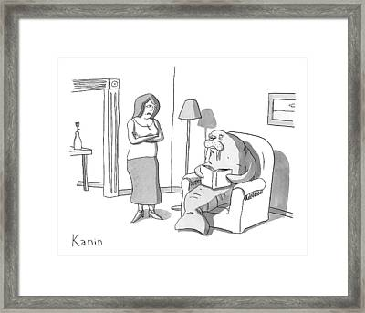 A Woman Is Seen Standing Next To A Walrus Who Framed Print by Zachary Kanin