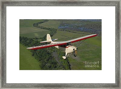 Aeronca Chief Flying Over Sacramento Framed Print by Phil Wallick