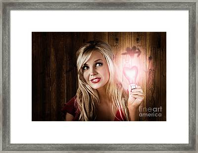 Attractive Young Blond Girl Holding Love Light Framed Print by Jorgo Photography - Wall Art Gallery