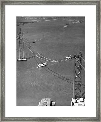 Bay Bridge Under Construction Framed Print by Charles Hiller