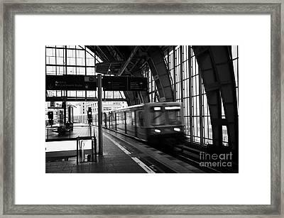 Berlin S-bahn Train Speeds Past Platform At Alexanderplatz Main Train Station Germany Framed Print by Joe Fox