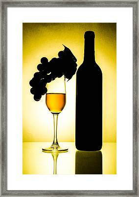 Bottle And Wine Glass Framed Print by Sirapol Siricharattakul