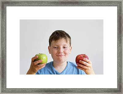 Boy Holding Red And Green Apple Framed Print by Gombert, Sigrid